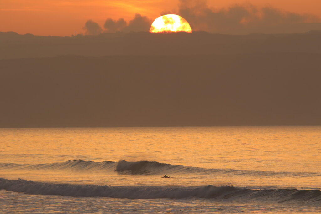 Gwithian sunset Cornwall surfer