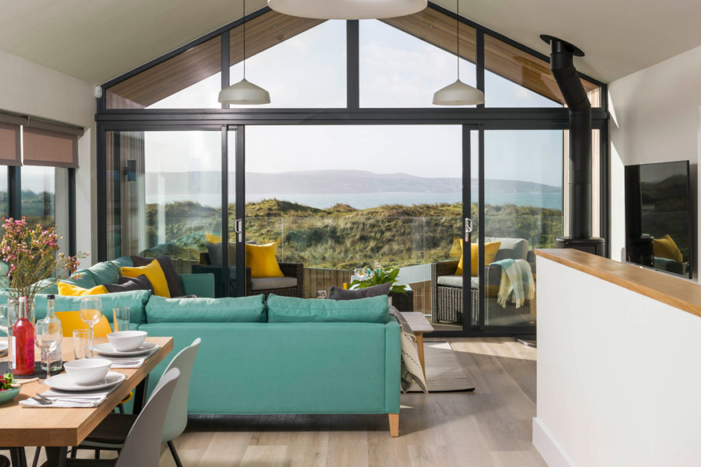 Lounge and view from Dune Lodge luxury beach house at Gwithian from Forever Cornwall