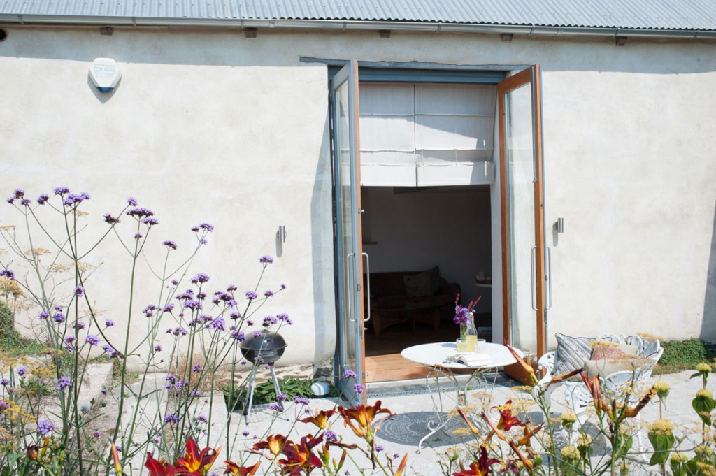 French doors and garden at Howthere Barn boutique holiday cottage at Kestle Barton near Helford
