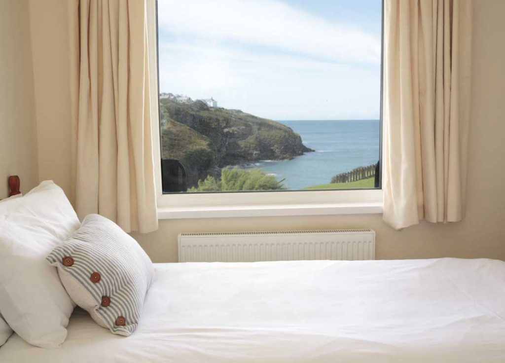 Bedroom at Lower Tregudda Dog-friendly Apartment Port Gaverne by Forever Cornwall Holiday Cottages