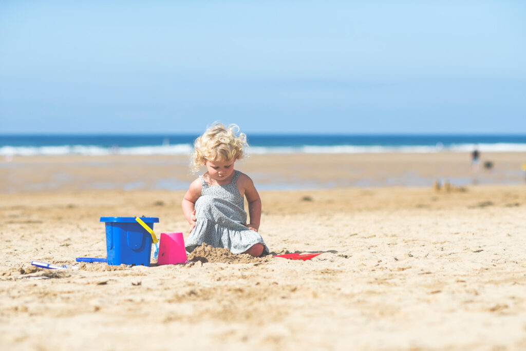 Child on beach Cornwall, family friendly holidays