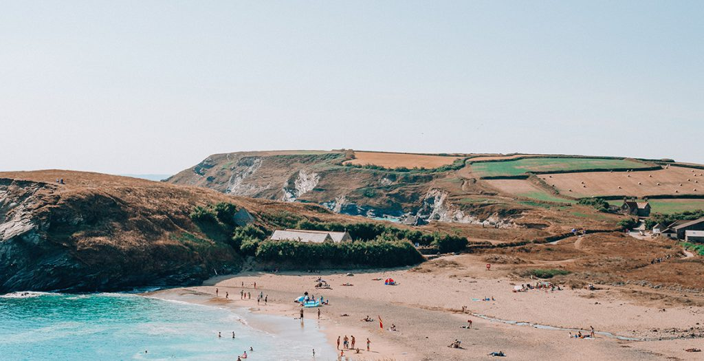 People on holiday in South Cornwall at Gunwalloe Beach, The Lizard