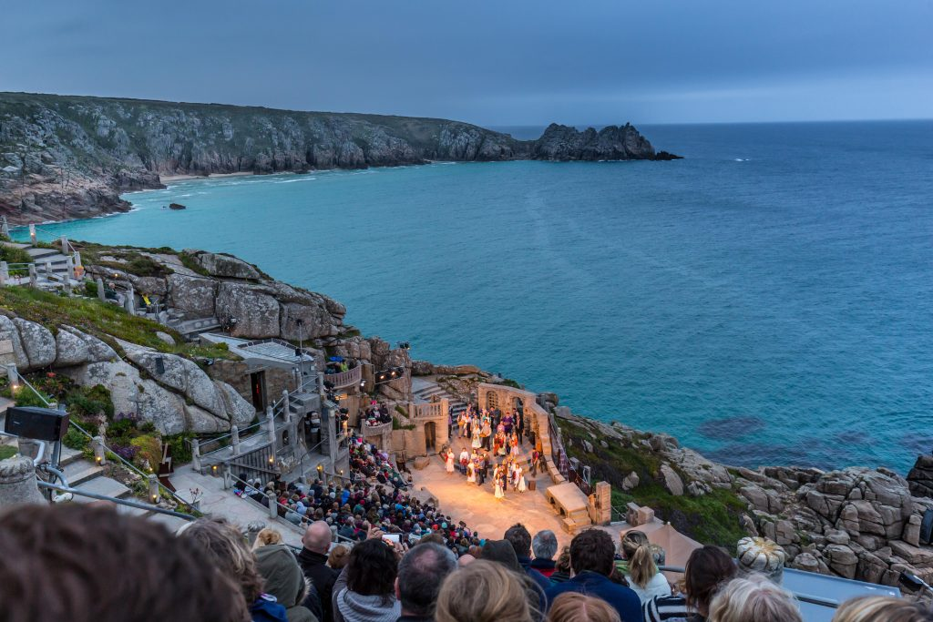 Outdoor Performance At Dusk At The Minack Theatre In Cornwall