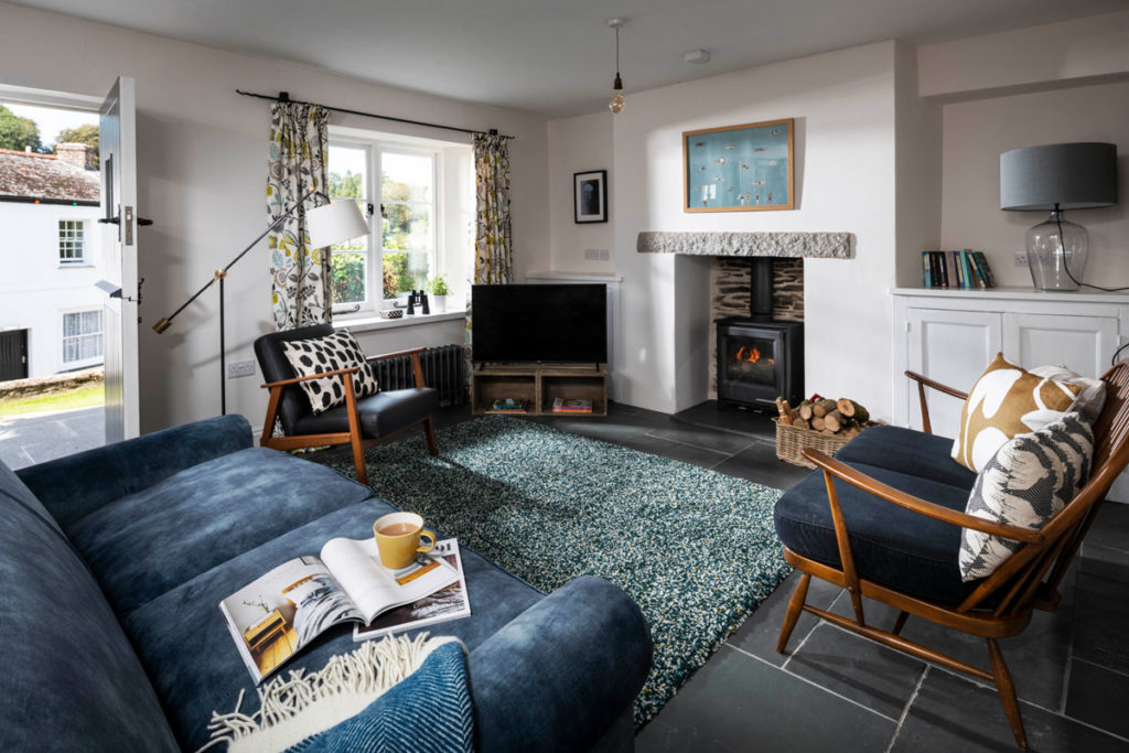 Sofas and chairs in living area inside Lerryn holiday cottage