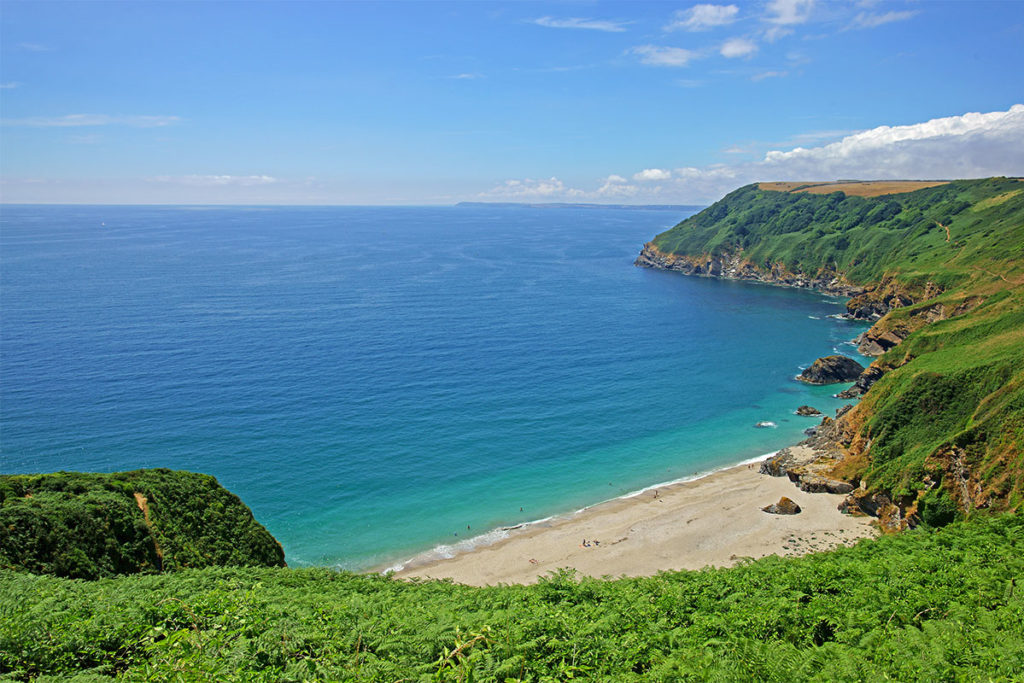 Beach near holiday cottages on the Fowey River by Forever Cornwall