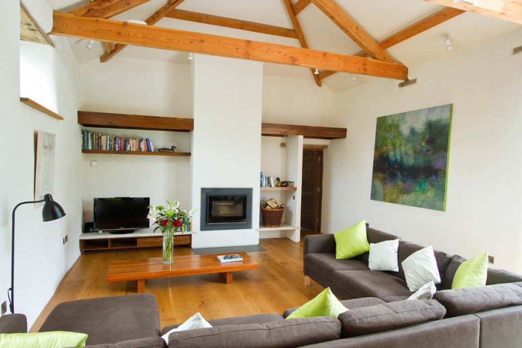 Living area inside Avallen Barn conversion luxury holiday accommodation near Helford