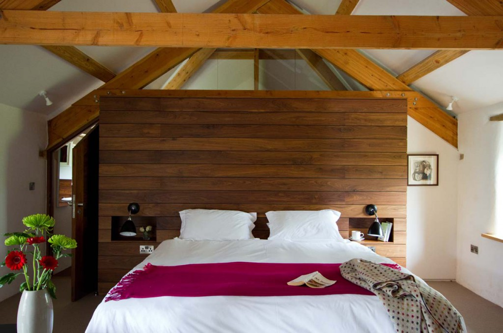 Beams in bedroom at Avallen Barn luxury holiday cottage near Helford