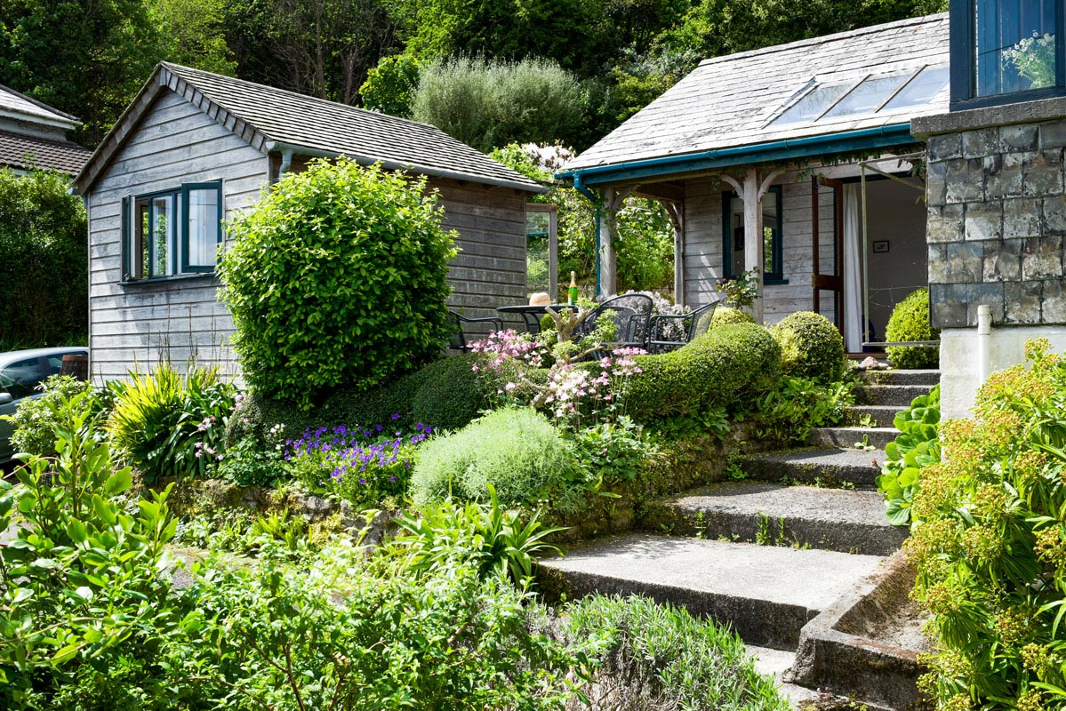 with cornwall holidays thatch village cottage gardens cornish of cottages in holiday