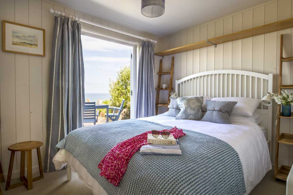 Bedroom inside chalet with sea views at Gwithian Towans - Surfside Beach Chalet from Forever Cornwall