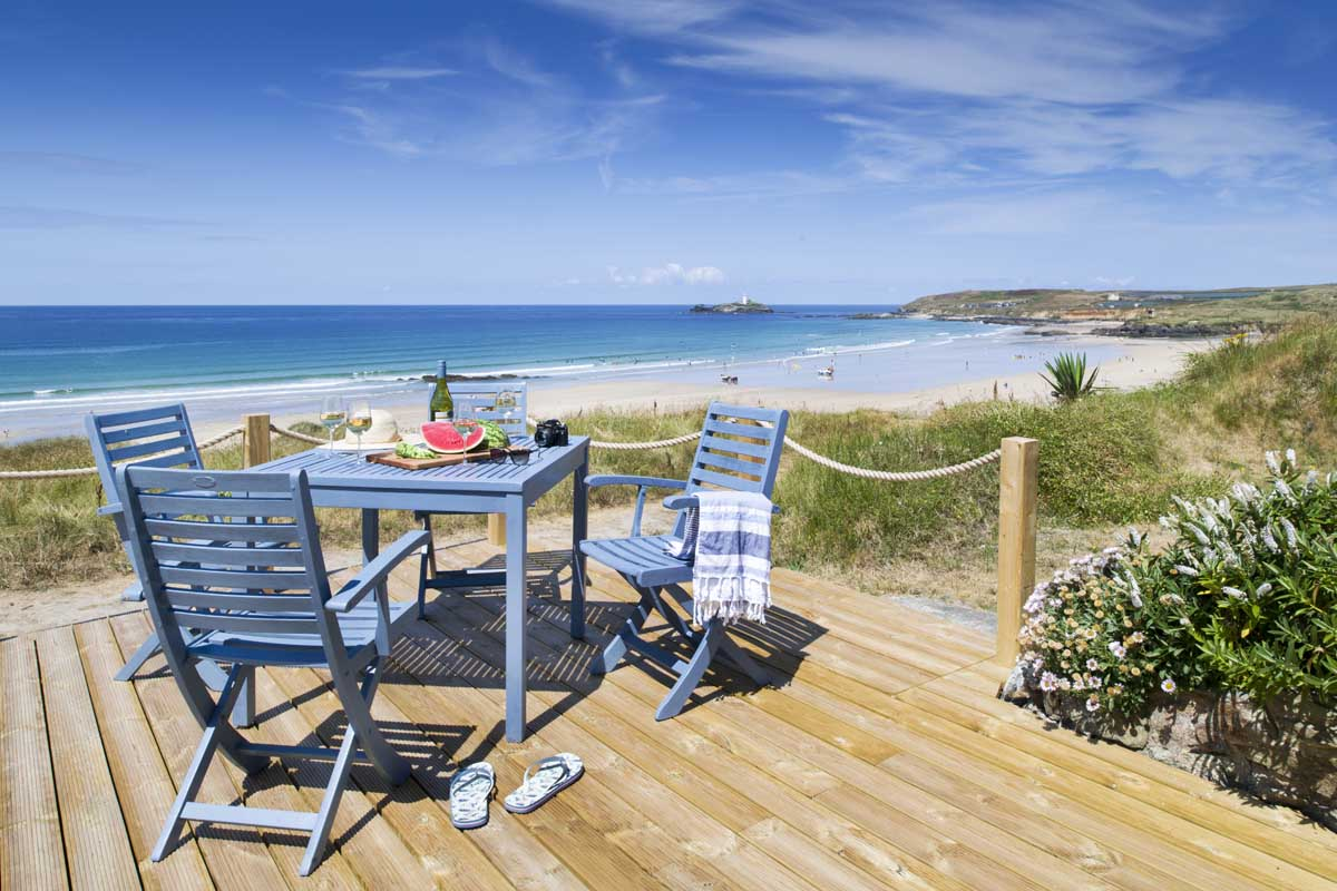 Sun deck at chalet with sea views at Gwithian Towans - Surfside Beach Chalet from Forever Cornwall