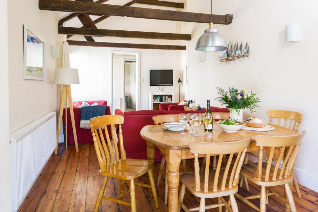 Dining area at cottage with sea view at Port Gaverne - Rashleigh Cottage by Forever Cornwall