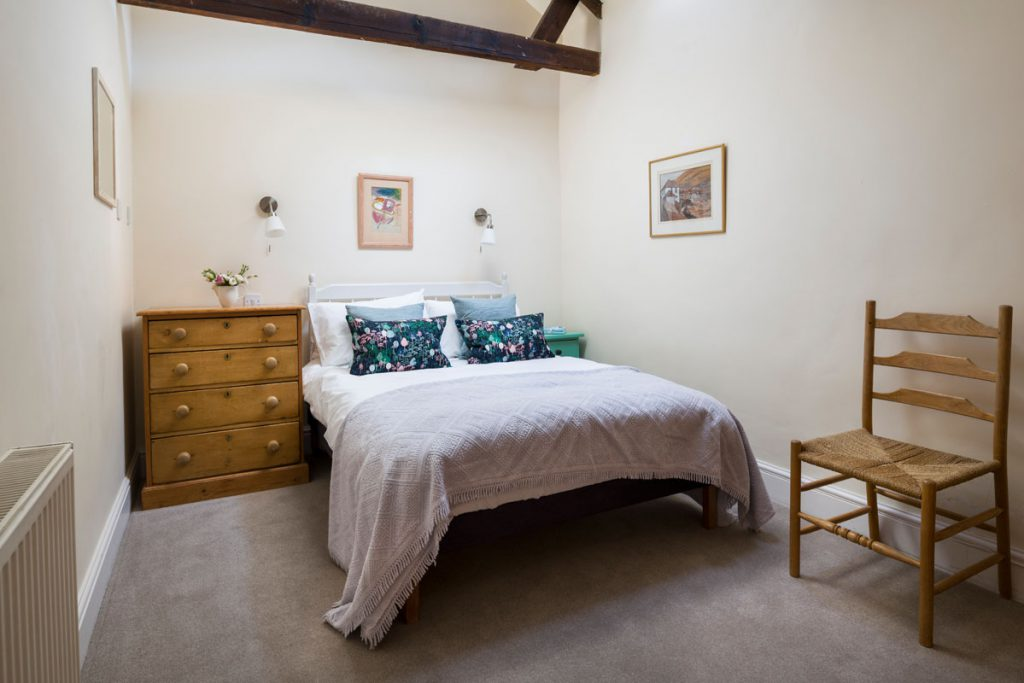 Bedroom at cottage with sea view at Port Gaverne - Rashleigh Cottage by Forever Cornwall