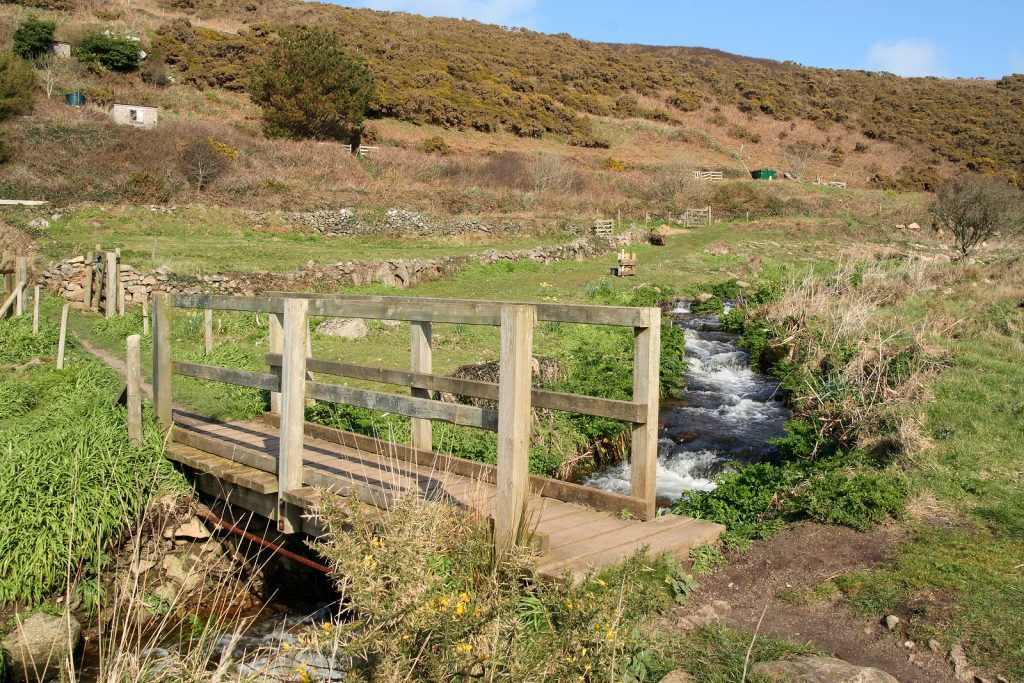 A Wooden Bridge Across A Stream In The Kenidjack Valley.